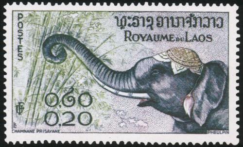 Лаос. 1958. № 45. 20 центов. Слон. Рис. Шамнан Лрисаван. Многоцветная. Гравюра на металле. Зуб. 13.